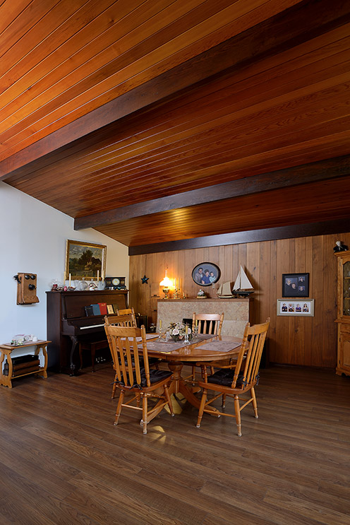 Stunning woodwork, midcentury lines and even the fireplace is so on point.
